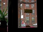 Manhattan Ave from a coffee shop on rainy day; Greenpoint, Brooklyn.